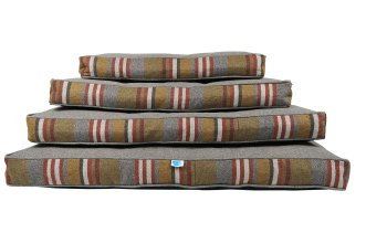 stack of Messy Mutts rectangular dog beds