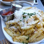 seasoned gourmet cheese fries at cafe in Balboa Park in San Die