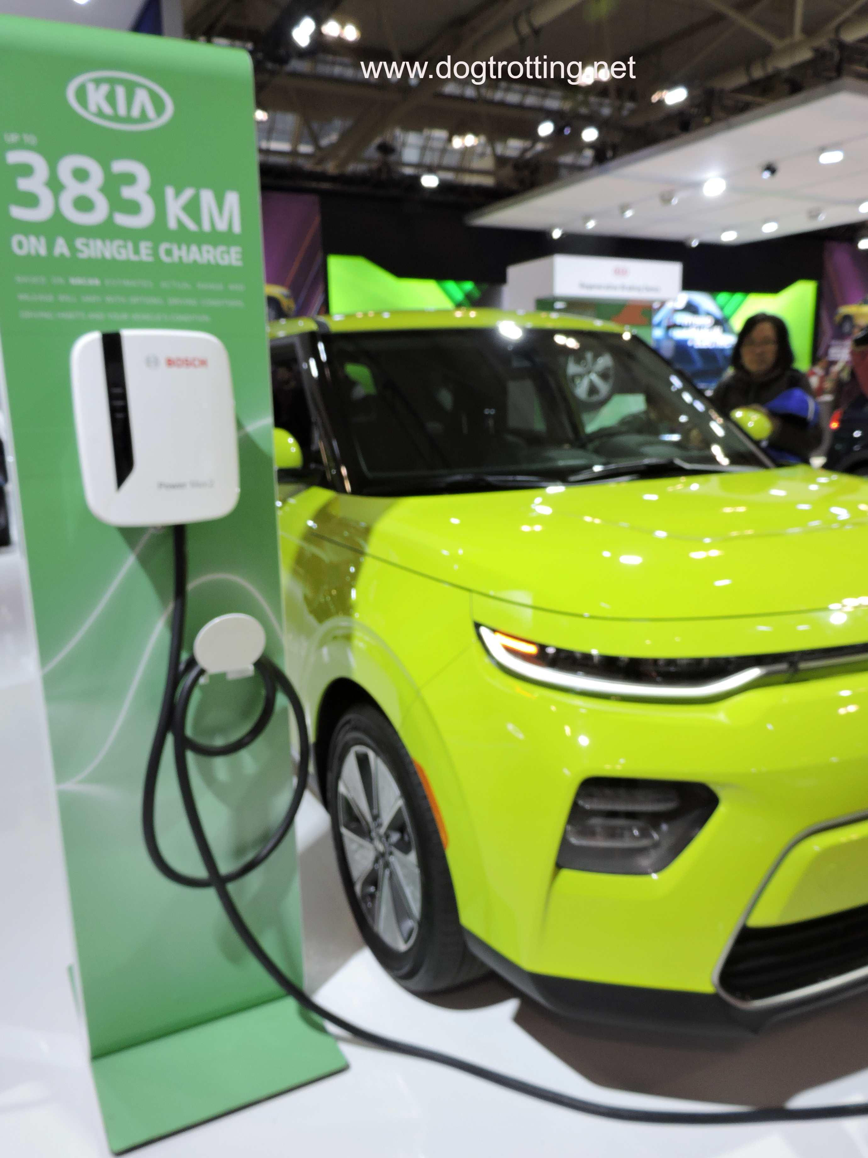 neon green electric kia soul at auto show