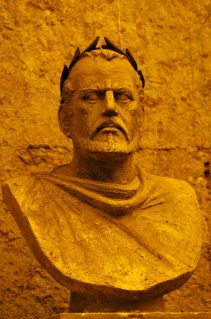Here's Split's master builder: Diocletian is now consigned to the basement -- a location that survived intact only because it was filled with trash. He was probably the first to wear the gold crown and forbade anyone to wear purple except the emperor. A religious conservative, he promoted the idea that the emperor is a logical extension of the gods and claimed that he himself was a descendant of Jupiter, the alpha Roman God. Therefore it's no surprise that the Christians who eventually won out revile him. (Diocletian exacerbated the problem by conducting the only empire-wide persecution of Christians.)