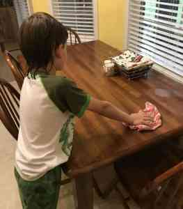Cleaning off the table is a great chore for younger children.