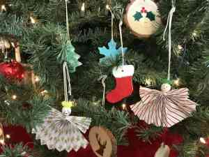 Assortment of homemade ornaments hanging on our Christmas tree