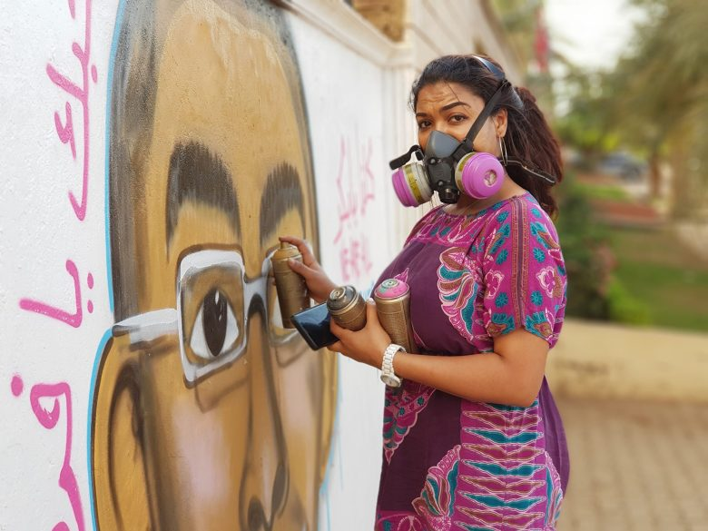 Assil Diab painting the streets of Sudan