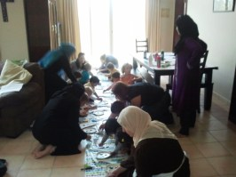 Preschoolers and preschool moms work on crafts.
