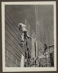 A courageous steel worker working on a section of the Grand Coulee dam east powerhouse. From the Library of Congress. Grand Coulee Dam, Columbia Basin Reclamation Project, Washington.