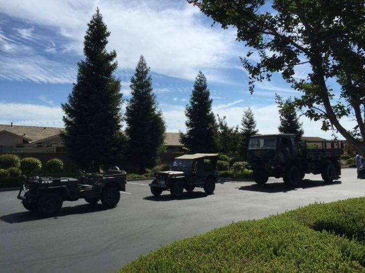 Antique military vehicles lined up for the Fourth of July parade.