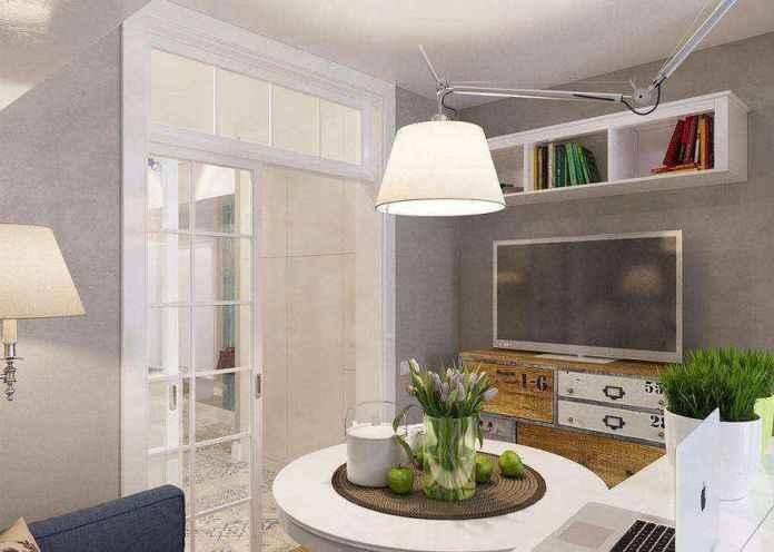 0-light-grayish-blue-studio-apartment-interior-design-in-modern-style-living-room-lounge-area-round-dining-table-pendant-lamp-flexible-arm-rod-chest-of-drawers-tv-set-floor-lamp-book-shelves | Как сделать удобной студию площадью всего лишь 25 квадратных метров? Узкая и маленькая студия