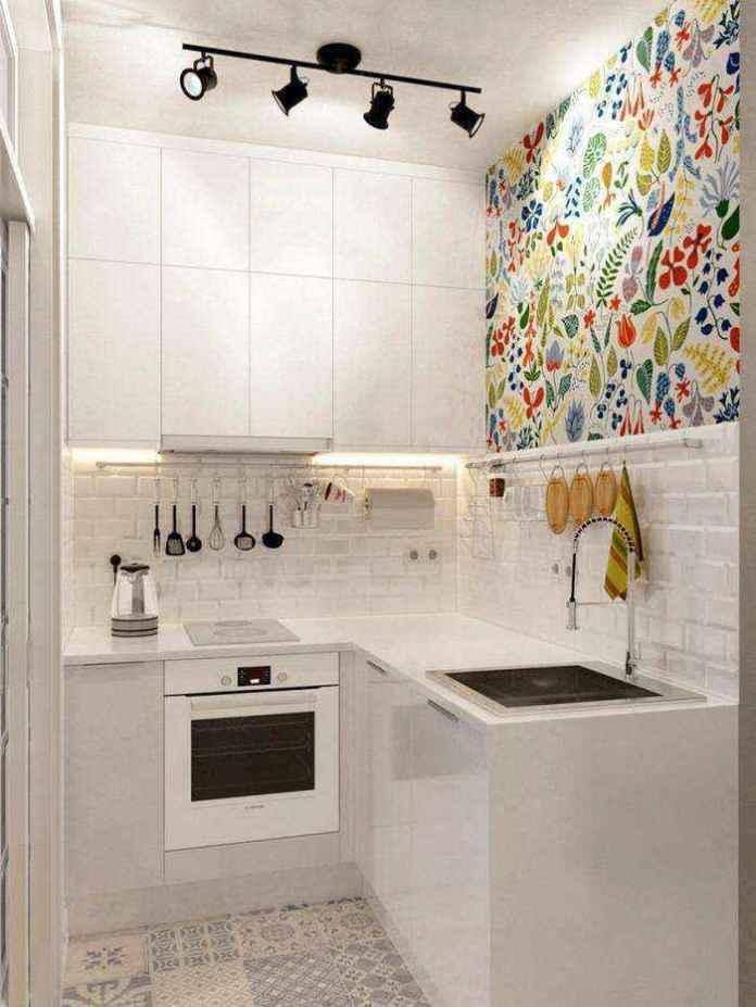 3-1-light-grayish-blue-studio-apartment-interior-design-in-modern-style-kitchen-white-top-cabinets-minimalism-floral-wall-tiles-l-shaped-set-beige-floor-tiles-white-backsplash | Как сделать удобной студию площадью всего лишь 25 квадратных метров? Узкая и маленькая студия