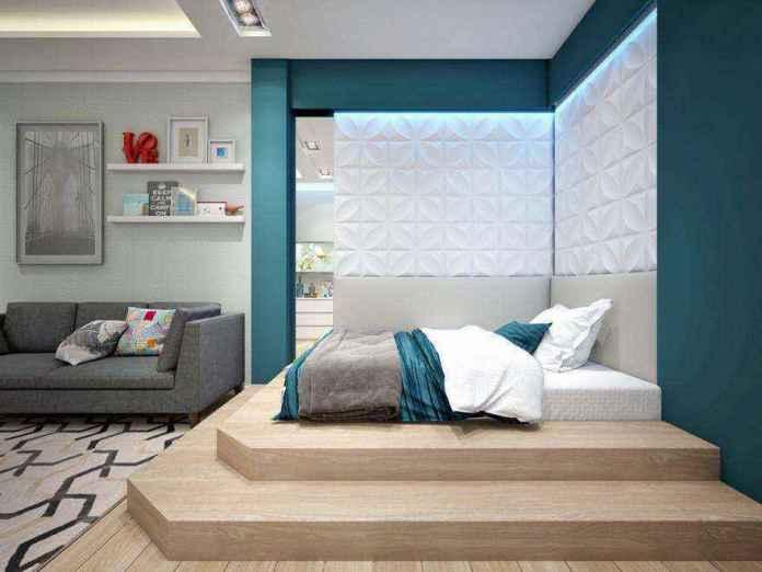 3-2-podium-bed-in-interior-design-contemporary-style-bedroom-light-gray-and-blue-geometrical-motifs-carpet-sofa-3d-wall-panels | Кровати с подиумом в дизайне интерьера: 5 реальных проектов в деталях