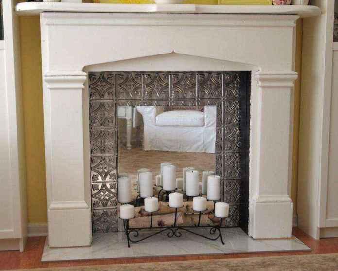 5-1-white-plasterboard-surround-mirrored-interior-with-candles-romantic-ideas-metal-wrought-candlestick-faux-fireplace-ideas | Идеи фальш-каминов: создание, декорирование и начинка
