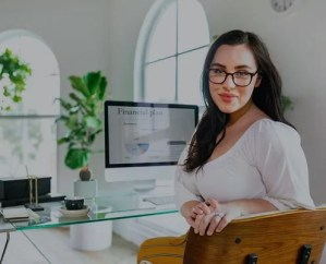 Woman Finance professional using accounts payable automation software for invoices