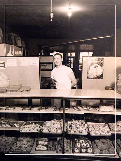 Gordon Zubriggen at his bakery in Sumner, IA, sometime just after WWII