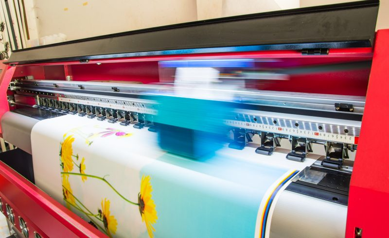 Web press printing machine at work