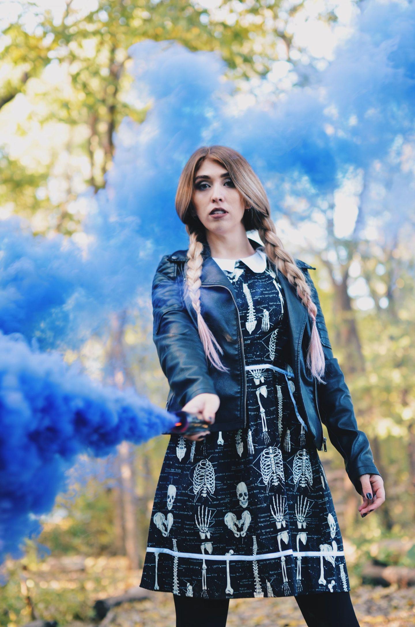 purple smoke bomb in skeleton dress