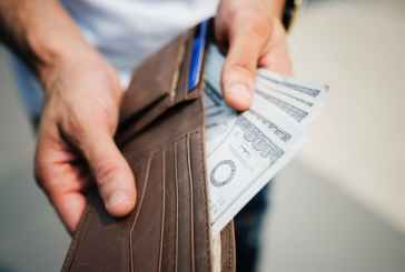 Man Holding Brown Leather-based-based Bi-fold Pockets With Money in It