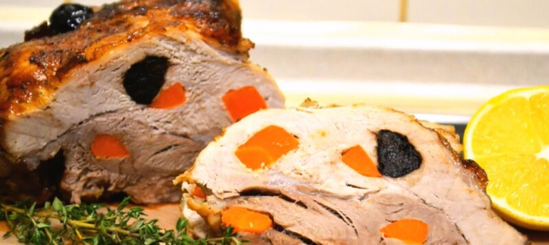 Delicious and juicy buynery homemade pork in a foil in the oven with prunes