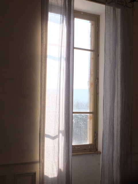 Linen curtains in breeze
