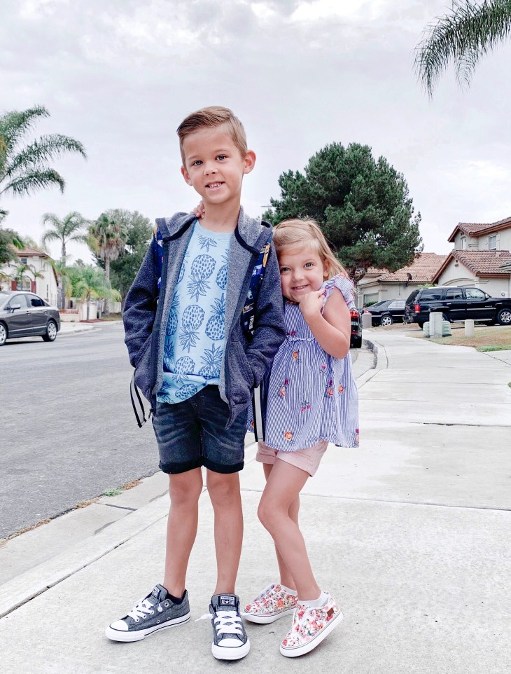 Back To School Shoes from Famous Footwear by popular San Diego fashion blog, Domestic Blonde: image of a little boy and girl standing outside together and wearing their new back to school shoes.