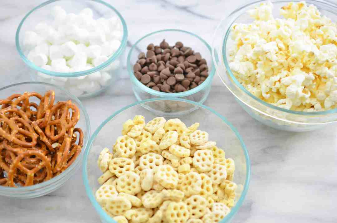 This snack mix recipe is made with a family favorite, Honeycomb cereal. This mix includes pretzels, popcorn, marshmallows, and is topped with a milk chocolate drizzle. A treat all kids will enjoy.