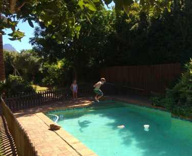 Jumping in the pool. This happened only twice during the week as the water was frigid