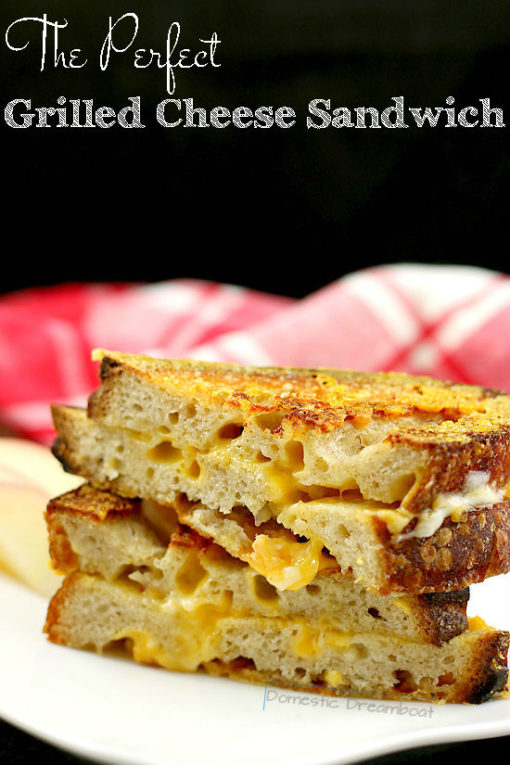 Head on photo of stacked grilled cheese sandwich halves with text title