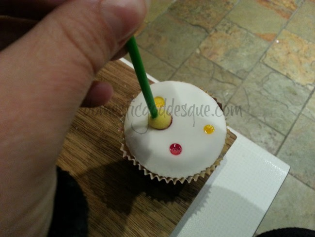 putting spots on Pudsey cupcakes
