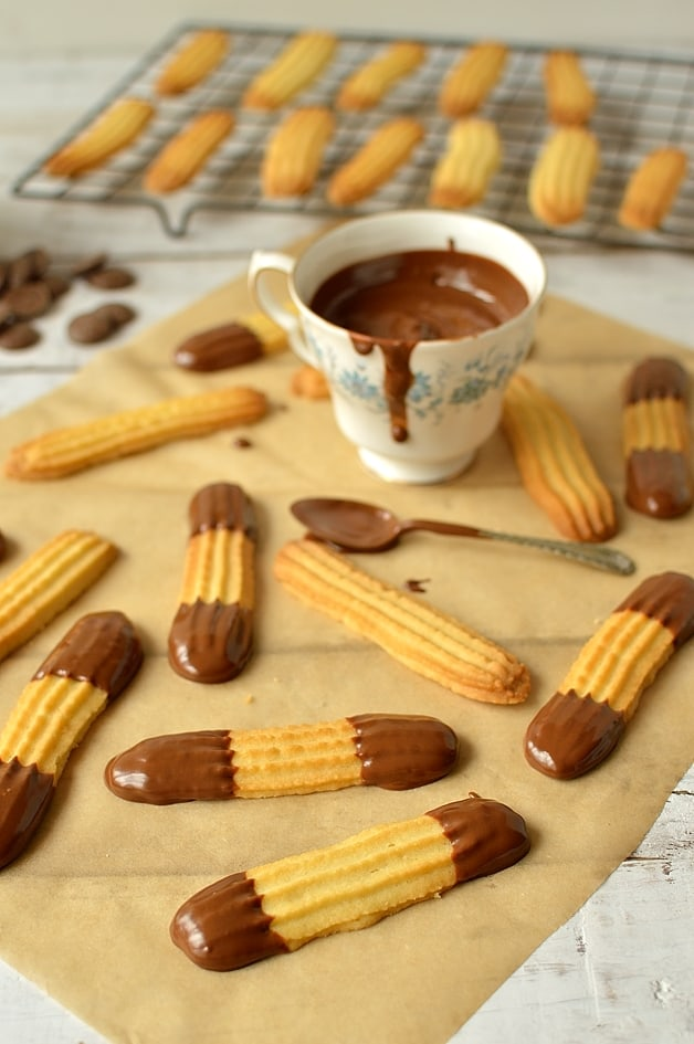 Chocolate dipped lime or orange viennese finger biscuits