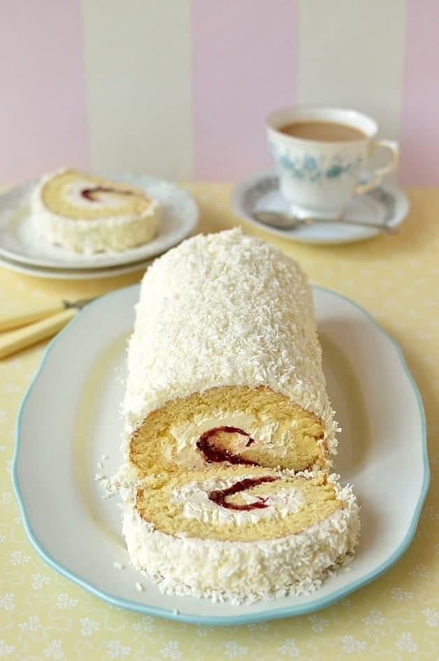 Cherry & coconut swiss roll cake - fatless sponge filled with cherry jam & coconut swiss meringue buttercream, the perfect cake for Mother's Day