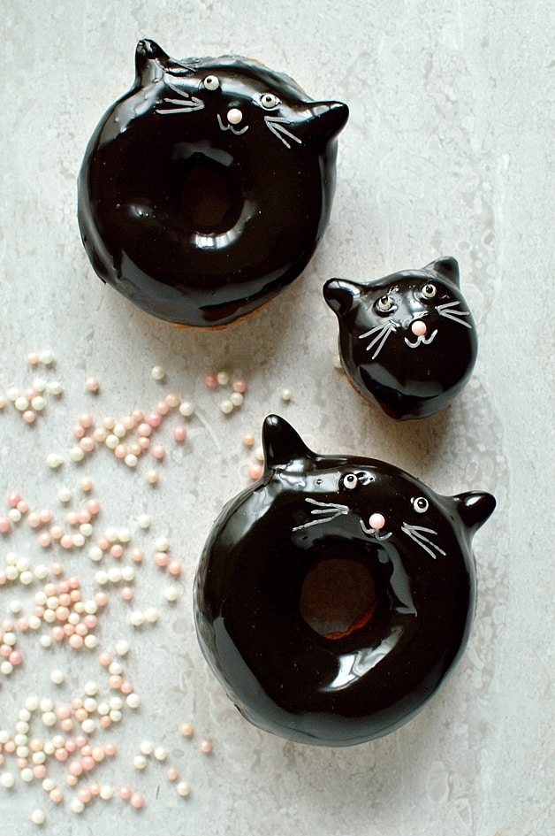 Chocolate glazed fried ring doughnuts with cute (and easy) cat face designs