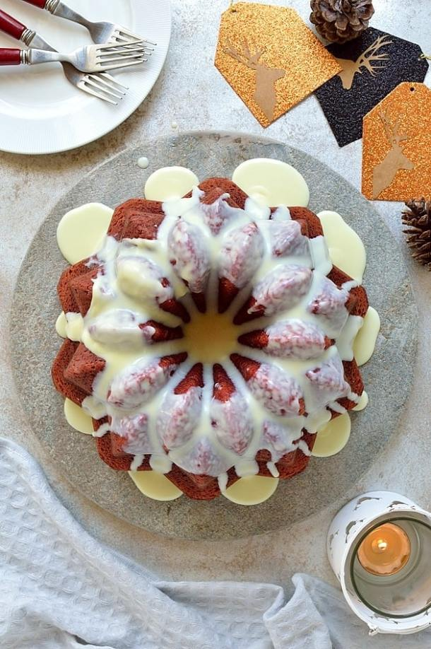 Red velvet bundt cake with white chocolate peppermint cream cheese glaze - the perfect festive cake!