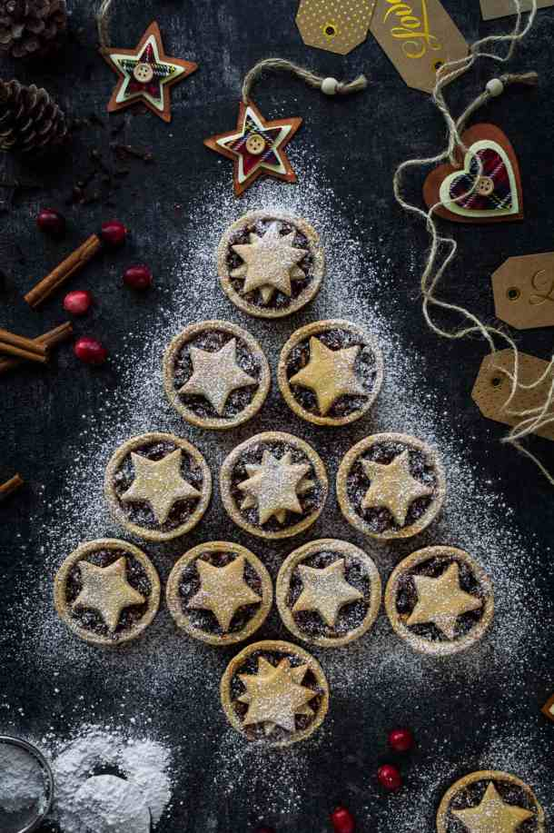 Lower calorie mince pies (vegan), arranged in a Christmas tree shape on a dark background.