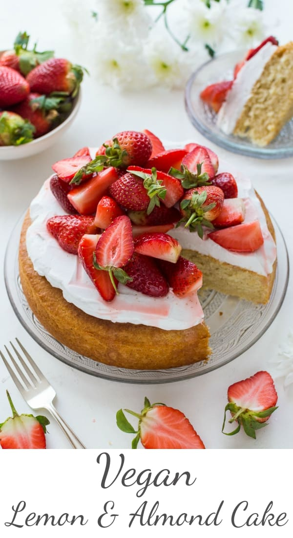 Vegan lemon almond cake with coconut whipped cream and macerated strawberries - a light, moist vegan lemon and almond cake topped with a cloud of coconut whipped cream and sweet macerated strawberries. The perfect cake for Spring! #vegan #baking #cake