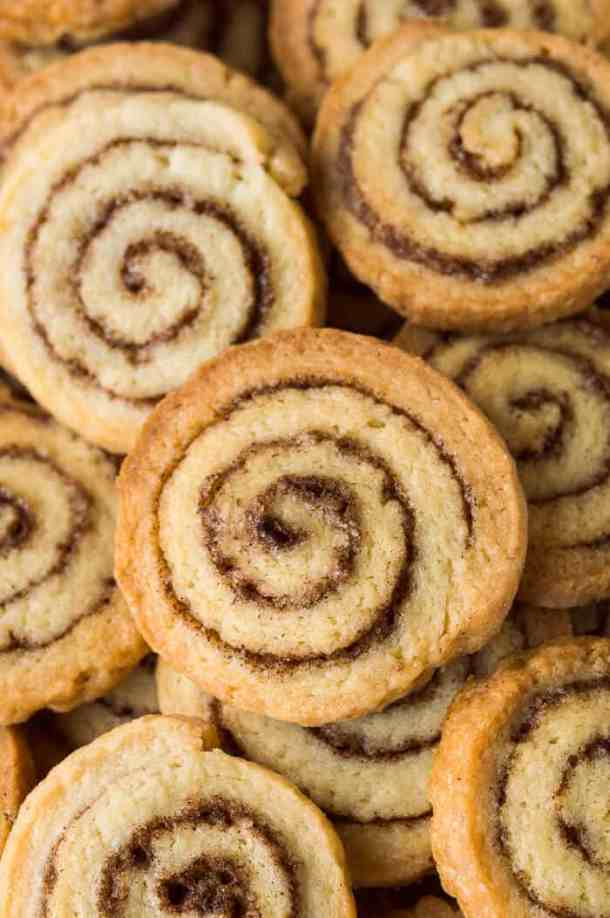 A close up of a pile of vegan cinnamon swirl cookies