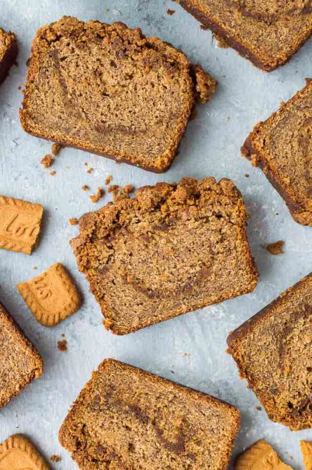 Slices of vegan biscoff cookie butter banana bread on a grey background.