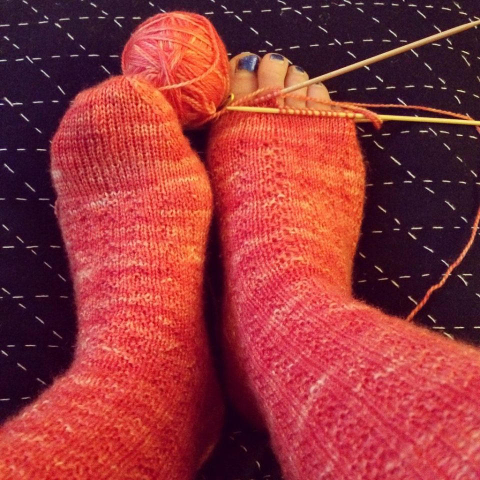 Trying on almost finished socks.