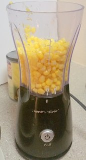scoop some of the corn into the blender