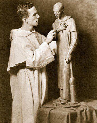"""A young Fr. McGlynn, O.P. sculpts """"St. Martin de Porres."""""""