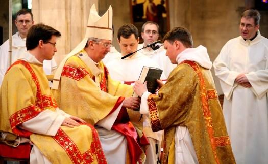 The handing over of the Gospel book to Bro Colm OP