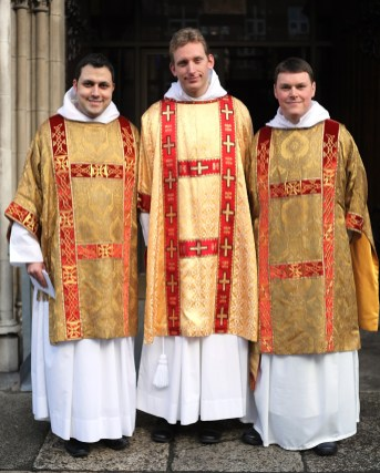 The three newly ordained deacons
