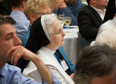 Sister listening to the address during the conference.