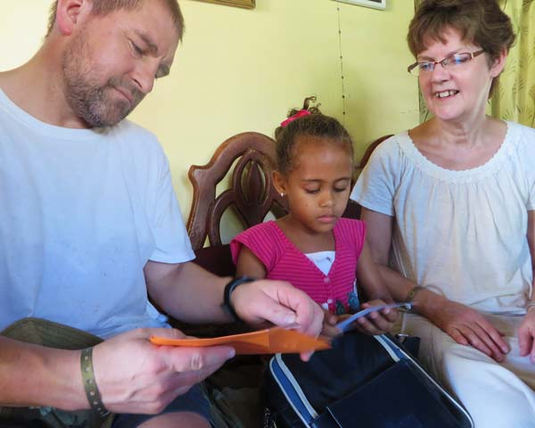 Ted and Esther Woberg with their sponsor child in the Dominican Republic.