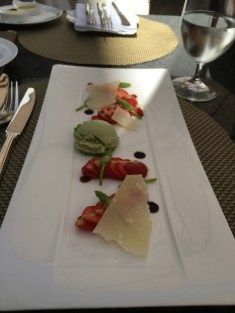 Strawberry carpaccio, avocado ice cream, wild green asparagus, parmigiano