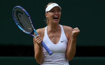 Russia's Maria Sharapova reacts after beating US player Coco Vandeweghe during their women's quarter-finals match on day eight of the 2015 Wimbledon Championships at The All England Tennis Club in Wimbledon, southwest London, on July 7, 2015. Sharapova won the match 6-3, 6-7, 6-2. RESTRICTED TO EDITORIAL USE -- AFP PHOTO / JUSTIN TALLISJUSTIN TALLIS/AFP/Getty Images