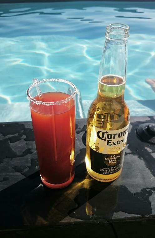 Corona+ tomato juice with spicy sauces, lime and salt