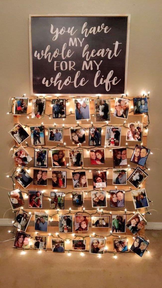 Penggunaan luar biasa palet kayu sebagai asas untuk foto keluarga yang mengikat