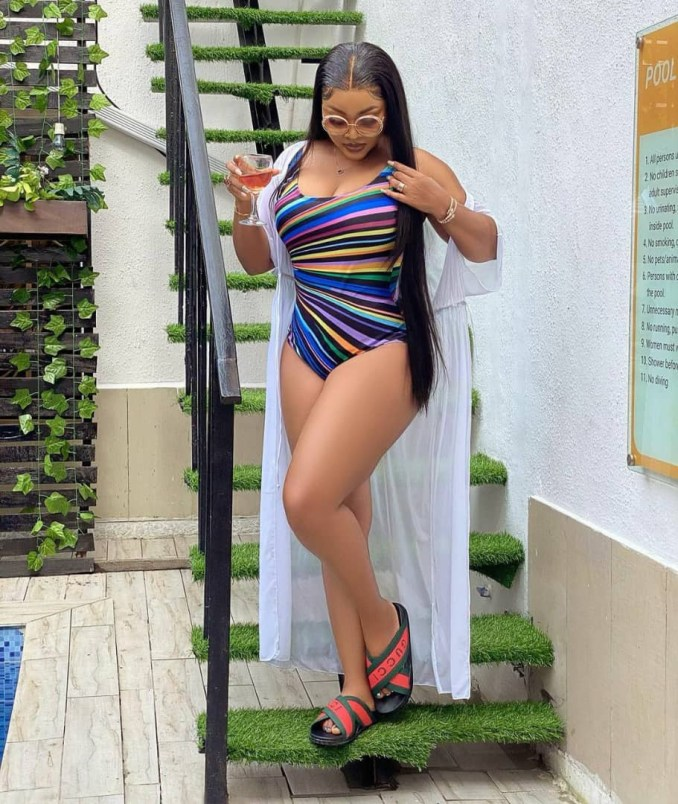 Mercy Aigbe flaunts her curves in multi-colored swimwear