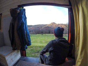 PIC BY JAMIE WADDINGTON/MERCURY PRESS (PICTURED: JAMIE WADDINGTON TAKES IN THE VIEW FROM HIS 16 YEAR OLD CONVERTED LDV VAN) A man fed up of wasting up to 800 a month on rent has made himself the perfect home and is saving 8,000 A YEAR - by creating a haven in the back of a rusty old van. Jamie Waddington, 25, believes an early mid-life crisis prompted him to create his dream home complete with a SKYLIGHT in a rusty, 16-year-old LDV white van, which he bought for just 750. Jamie says he became tired of frittering so much money on expensive house-shares so instead worked 80-hour weeks on various jobs including the fire service and outdoor companies to raise the cash for his new lifestyle. The van features a rustic wooden interior finished with beautifully carved handles, skylight and carpet, complete with numerous shelves, cupboards, a hob, fridge, sink, sofa and fold-out bed. It even has a fire extinguisher and carbon monoxide detector. SEE MERCURY COPY