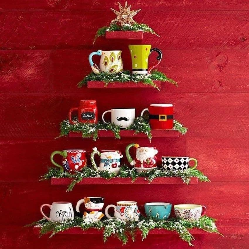 Stylish shelves with mugs in the shape of a Christmas tree
