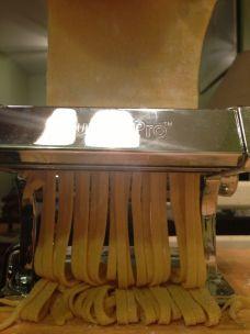 Feed through pasta maker.