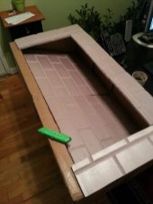 3) Reshape the box to a fireplace shape, with an opening for the hearth.